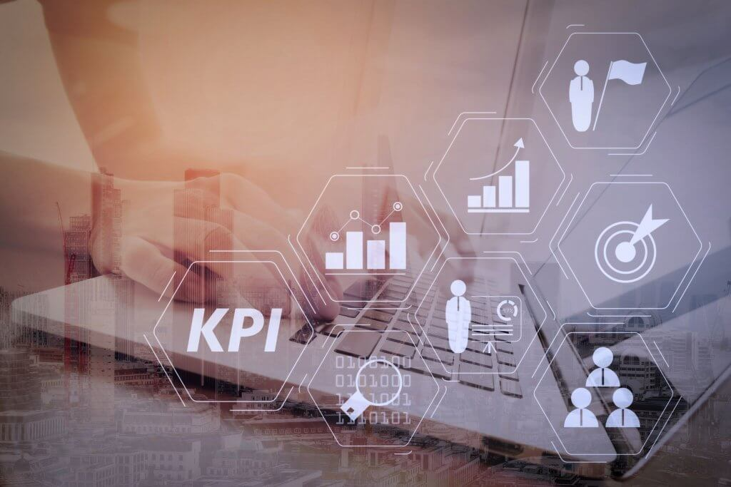 KPIs concept image of icons in front of business man working on laptop