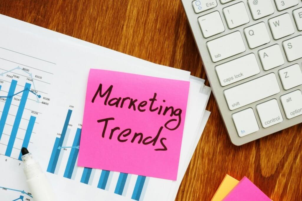 marketing trends graphs next to keyboard