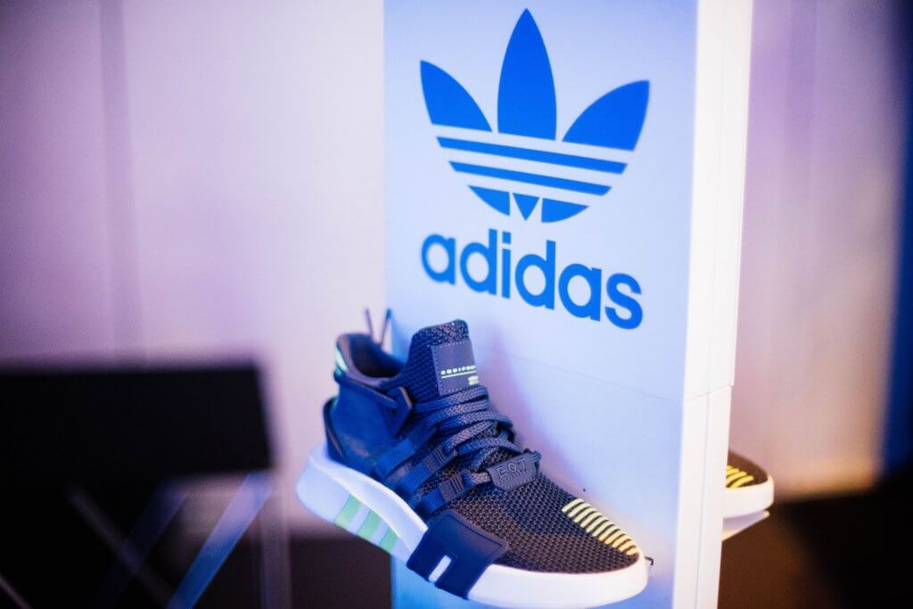 adidas shoe displayed on store as part of marketing strategy